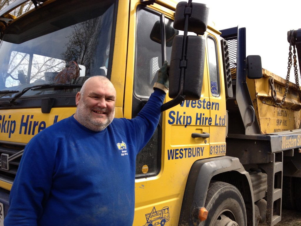 Mike from Western Skip Hire delivers the top soil.
