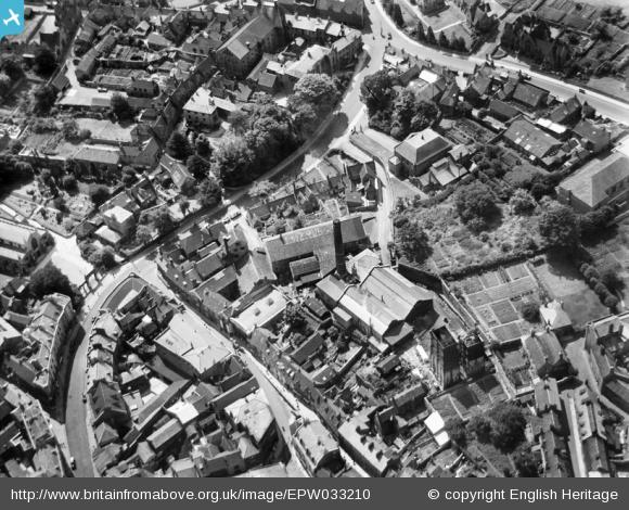 Bath Street winds its way through the centre of the photograph. The allotments are on the right hand side of the photograph. The site was used for housing and parking.